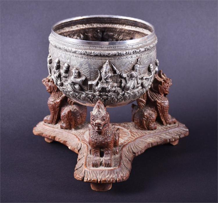 A good 19th century Burmese Rangoon silver bowl with deep relief and incised decoration of figures