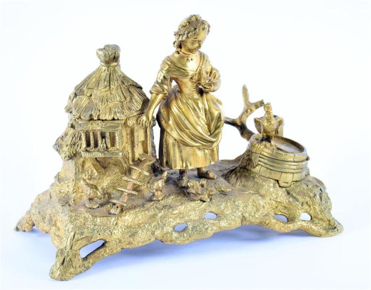A late 18th/early 19th century French ormolu ink stand with two wells, one in the form of a chicken