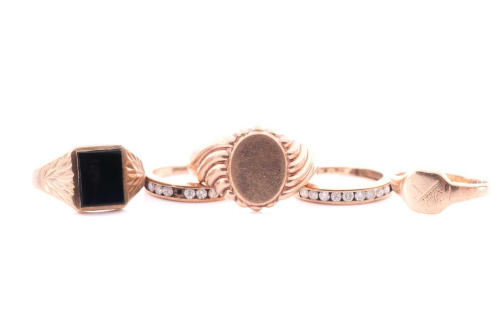 A 9ct yellow gold signet ring, size V, together with a small 9ct yellow gold signet ring, size M, two 9ct gold and white stone band rings, and a 9ct gold and black onyx signet ring (shank a/f). (5)