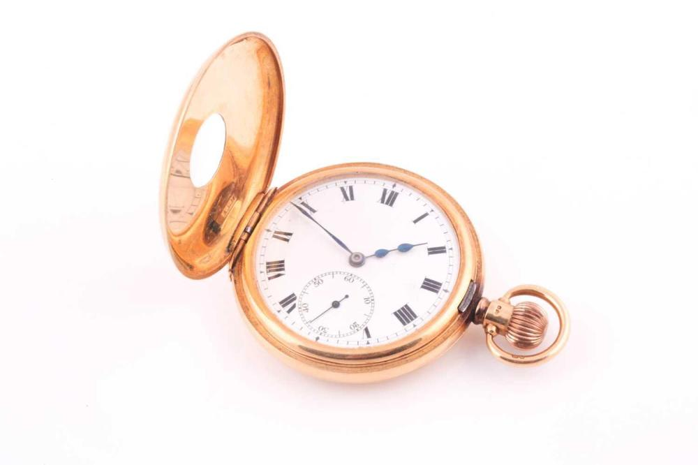 An 18 carat gold half hunting cased pocket watch; with enamelled outer chapter ring, white enamel dial, Roman numerals, and subsidiary seconds at six o'clock. Keyless lever Rolex movement, the case Brimghm 1919 by the Dennison Watch Case Company....