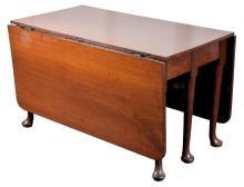 A large George III mahogany pad foot gate leg dining table