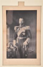 Framedthreequarter length portrait of King George V (1865-1936)in full naval uniform