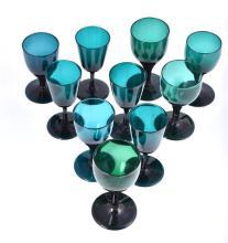 A matched set of ten late Georgian Bristol green stemmed wine glasses