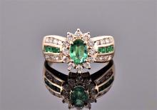 An 18 carat yellow gold, diamond, and emerald cluster ring