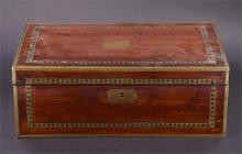 A Victorian rosewood brass bound writing box