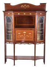 An Edwardian Art Nouveau mahogany display cabinet