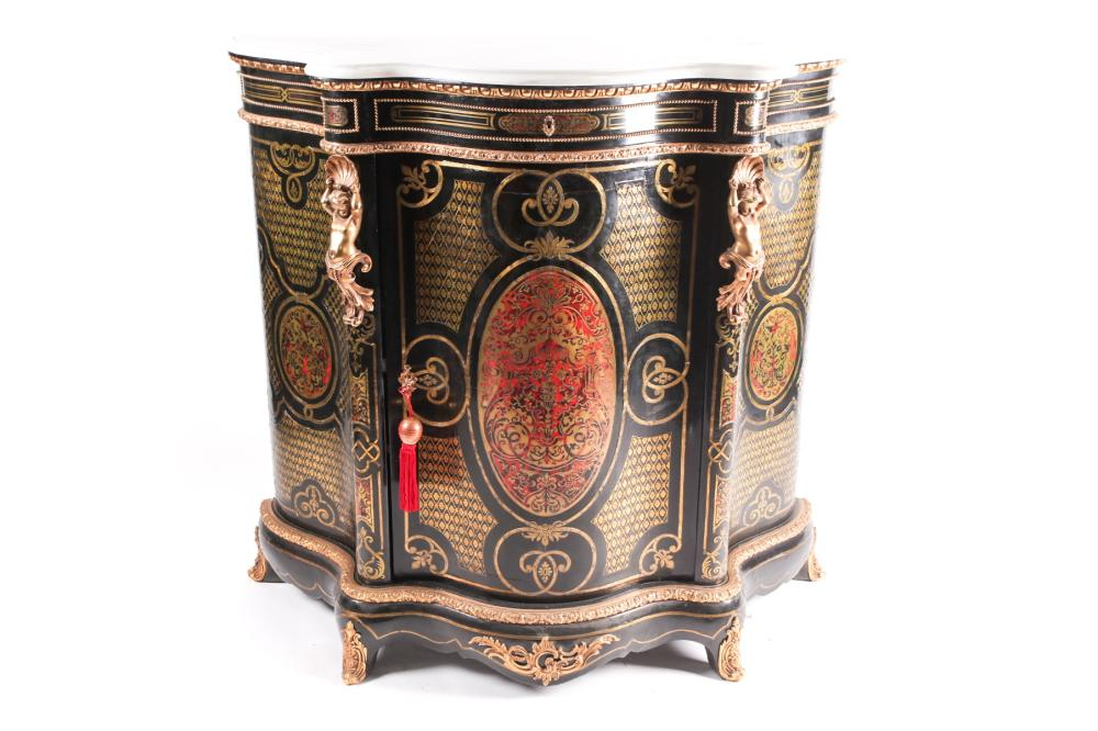 A 19th century French ebonized and red Boulle inlaid serpentine single door credenza, with shaped marble top gilt metal figural amorini mounts, on a shaped plinth base. 116 cm wide x 51 cm deep x 111 cm high.