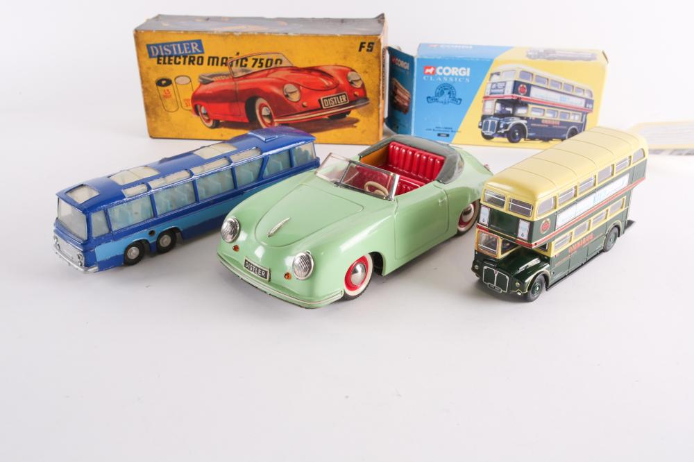 A Distler Electromatic 7500 tinplate Porsche 356, battery operated issue, in original box, together with a boxed Corgi Classics Shillibeer AEC Routemaster Bus Set 35003 and a loose Dinky Supertoys Vega Major Luxury Coach 952.