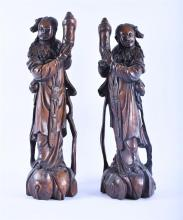A large pair of Japanese Meiji hardwood carved figures