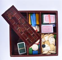 A late 19th century Japanese crimson lacquer lidded games box