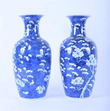 A pair of mid 20th century Japanese blue and white vases