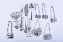 A collection of assorted silver items including decanter labels, and other items.