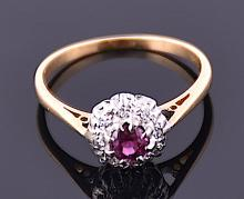 A yellow gold, diamond, and ruby cluster ring