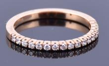 An 18ct rose gold and diamond half eternity ring