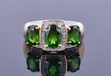 A 14ct yellow gold, diamond and green garnet ring