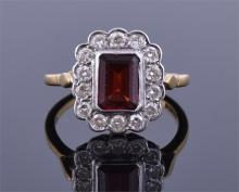 An 18ct yellow gold, diamond, and garnet ring