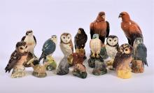 A collection of 15 Royal Doulton and Beswick whisky bottles  in the form of birds, some complete