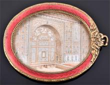 An Indian late 19th century oval ivory panel of an interior of a prominent Mogul palace set in a red