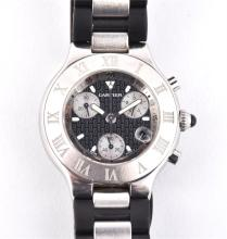 A Cartier '21' stainless steel chronograph wrist watch theblack dial decorated with Cartier logos,