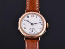 A gentleman's early 20th century 9ct gold watch the white enamel dial with black Arabic numerals