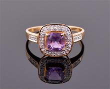 A 9ct yellow gold, diamond and amethyst ring the cushion cut central stone within a rounded square