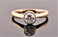 A 14ct yellow gold and solitaire diamond ring bezel set with an old round cut diamond, approximate