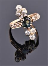 An unusual 18ct yellow gold, diamond and tourmaline ring set with an oval cut blue tourmaline,