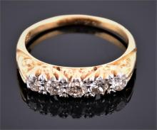 An 18ct yellow gold and diamond five stone ring the ornate mount set with five old cut diamonds of