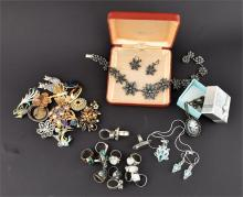 A collection of silver rings  together with a collection of brooches, two necklace and earring