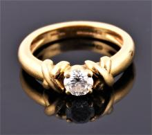 An 18ct yellow gold and solitaire diamond ring, by Mappin & Webb set with a round cut diamond of