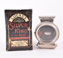 A 'Silver King' oil-powered bicycle lamp by Joseph Lucas, dating from the 1920s, boxed and with 4