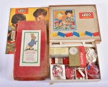 An original 1950s/60s Lego System cased town street scene with bricks and cars, and a layout mat,