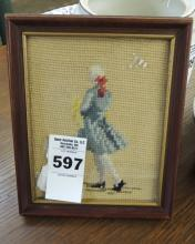 Needlepoint of man in frame