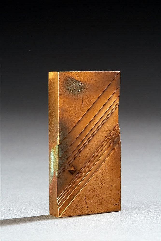 Yves Millecamps?(né en 1930) Presse papier en bronze a décor géométrique.