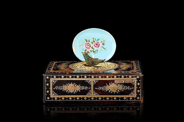 Boîte à musique à l'oiseau chanteur aux incrustations florales et d'étoil