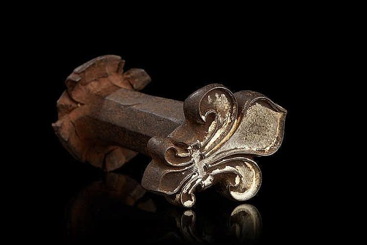 Cachet en fonte de fer représentant une fleur de lys. Epoque XVIIIe siècle