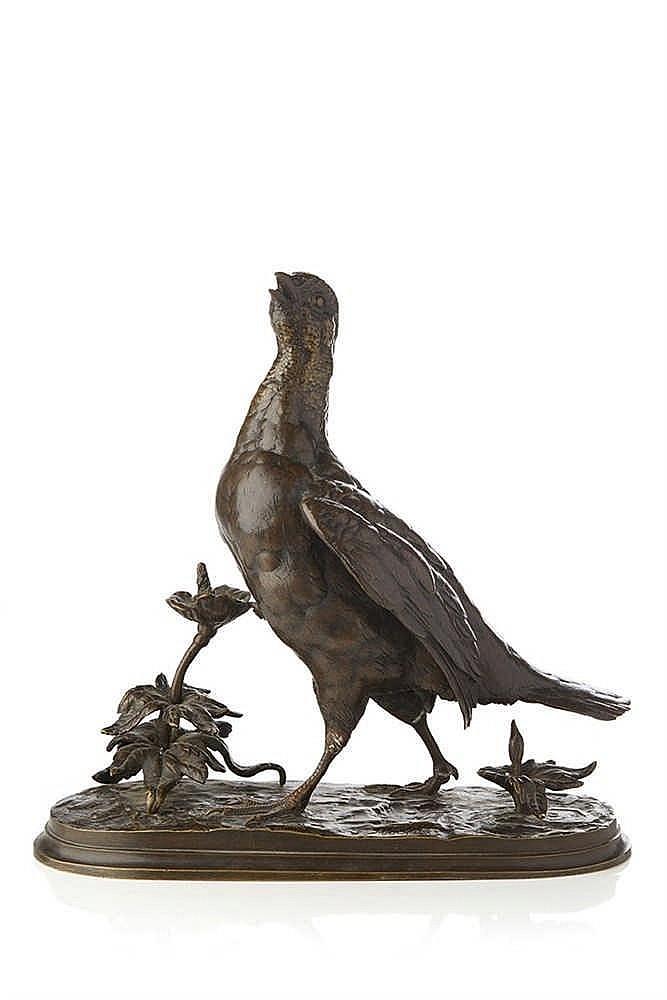 Perdrix  Groupe en bronze ciselé et patiné représentant une perdrix rappela