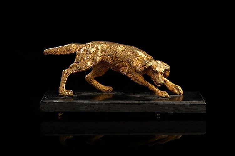 Petit bronze figurant un setter. H : 3,5 cm - L : 8,5 cm - P : 3,5 cm