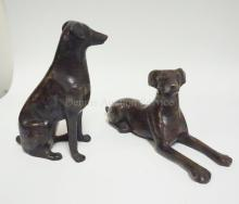 PAIR OF BRONZE DOGS- ONE SITTING, ONE LAYING DOWN. TALLEST 7 1/4 IN