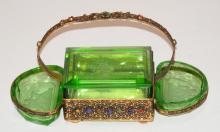 INTAGLIO CUT AND FACETED 3 PC GREEN GLASS SMOKING SET IN A JEWELED BRASS HOLDER W/ HANDLE. 7 1/4 IN W, 4 1/4 IN H