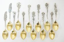 12 REED AND BARTON STERLING SILVER DEMITASSE SPOONS W/ FLOWER HANDLES AND GOLD WASHED BOWLS. 4 IN,  4.085 T OZ