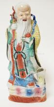CHINESE PORCELAIN FIGURE OF A MAN. 13 IN TALL. HEAD OF BIRD BROKEN OFF.