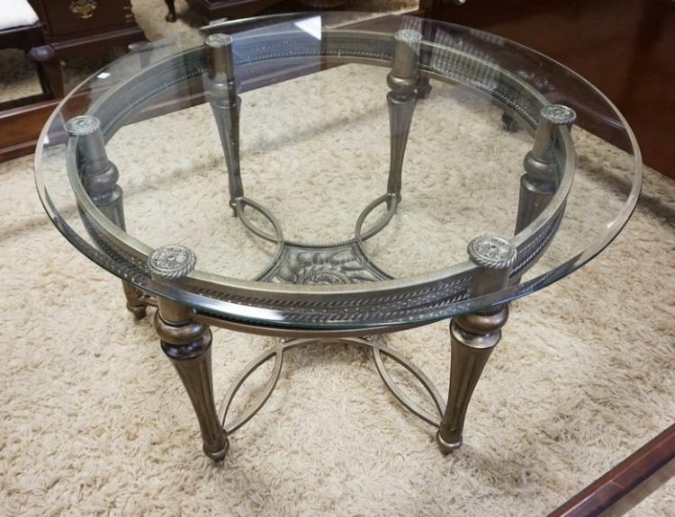 Round Coffee Table With An Ornate Base And A Glass Top 40
