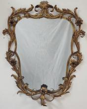 GILT WROUGHT IRON MIRROR IN A FLOWER AND LEAF DESIGN. 36 1/2 IN X 28 IN