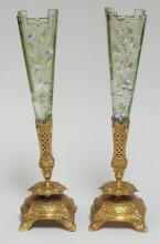 PAIR OF SINGLE LILY EPERGNES W/ PASTEL GREEN ENAMELLED INSERTS W/ SCULPTED TOPS IN ORNATE BRASS HOLDERS. ONE INSERT HAS A CHIPPED TOP CORNER. 12 IN H