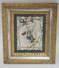 VICTORIAN DIE CUT IN A GOLD AND SILVER GILT FRAME. SOME DAMAGE ON BOTTOM EDGE OF FRAME. 6 1/4 IN X 8 1/2 IN