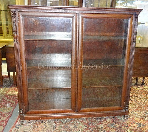 MAHOGANY BOOKCASE W/2 GLASS DOORS; HAS CARVED &