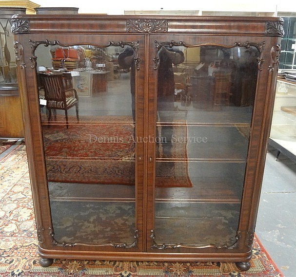 CARVED MAHOGANY BOOKCASE W/2 GLASS DOORS; BUN