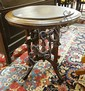 ROUND WALNUT VICTORIAN LAMP TABLE W/NICE CARVED UNDERCARRIAGE; 27 IN DIA