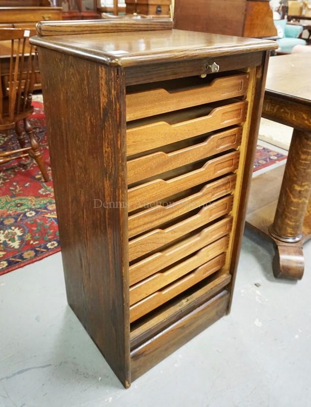 Oak music cabinet with a tambour door and interior drawers for 15 inch wide closet door